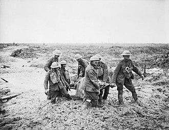 Battle of Pilckem Ridge - British stretcher bearers carrying a wounded man over deep mud near Boesinghe