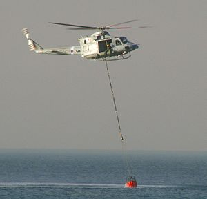 No. 84 Squadron RAF - 84 Squadron Bell Griffin HAR2 dips its bucket off the coast of Atlit, Israel during firefighting efforts on December 3, 2010