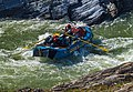 Rafter rowing through Sheep Slot Rapids on Firth River, Ivvavik National Park, YT.jpg