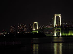 Rainbow Bridge (Tokyo) - Rainbow Bridge at night, lit in white lights.