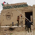 Raising the flag in Bala Murghab.jpg