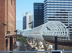 RandstadRail station Beatrixkwartier, nicknamed The 'Netkous' or Fishnet Stocking, with neighbouring skyscrapers