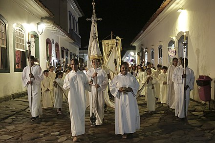 A Christian procession in Brazil, the country with the largest Catholic population in the world.[260]