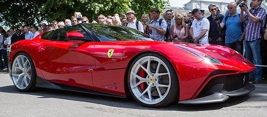 Red Ferrari F12 TRS facing right