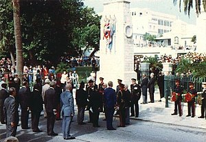 "Royal Bermuda Regiment - Remembrance Day parade, at the Cenotaph, in the City of Hamilton, 1990. HE The Governor, Major-General Sir Desmond Langley inspects war veterans, and is speaking with former Second-in-Command of the Royal Bermuda Regiment Major Donald Henry ""Bob"" Burns, MC."