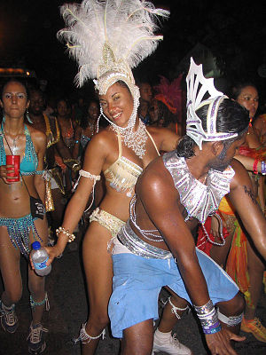 "Trinidad and Tobago Carnival - Two revellers dance in the streets. The form of dancing is called ""wining"" (winding) pronounced wine-ing"