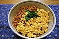 Rice bowl topped with stir-fried minced chicken and scrambled egg (8911650712).jpg