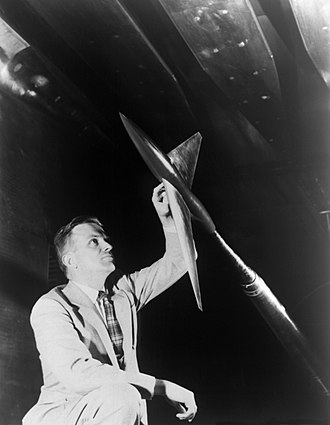 Area rule - April 1955: Whitcomb examines a model aircraft designed in accordance with his area rule.