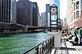 Riverwalk full of people dressed in green (6844843694).jpg