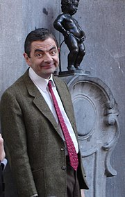 Rowan Atkinson as Mr. Bean, in Brussels, next to the Manneken Pis.