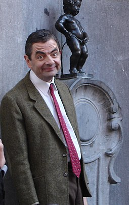 Rowan Atkinson as Mr. Bean Rowan Atkinson and Manneken Pis.jpg