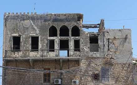The Empire Cinema building complex in the harbour area, damaged by IAF bombs RuinsFormerEmpireCinemaComplex TyreSourLebanon RomanDeckert16082019.jpg