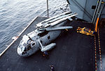 SH-3H of HS-17 on elevator of USS Abraham Lincoln (CVN-72) in 1990.jpeg