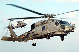 Magnetic anomaly detector - The SH-60B Seahawk helicopter carries a yellow and red towed MAD array known as a 'MAD bird', seen on the aft fuselage