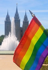 A gay pride flag in front of the SLC temple. SLC Temple Rainbow Flag.jpg