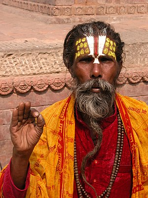 Nepali sadhu performing a blessing.