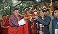 Sarbananda Sonowal presenting the sacred Bodhi Plant to the Prime Minister of Bhutan, Mr. Tshering Tobgay, at Mahabodhi temple, in Bodhgaya, Patna on January 17, 2015.jpg