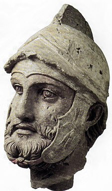 A sculpted head (broken off from a larger statue) of a Parthian wearing a Hellenistic-style helmet, from the Parthian royal residence and necropolis of Nisa, Turkmenistan, 2nd century BC Sarbaz Nysa.jpg