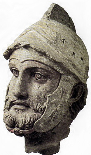 Roman–Parthian Wars - A sculpted head (broken off from a larger statue) of a Parthian soldier wearing a Hellenistic-style helmet, from the Parthian royal residence and necropolis of Nisa, Turkmenistan, 2nd century BC