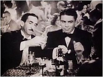 "Scarface (1932 film) - Osgood Perkins as John ""Johnny"" Lovo and Paul Muni as Antonio ""Tony"" Camonte in a scene from the film's trailer."