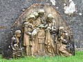Sculpture showing infant baptism - geograph.org.uk - 1289870.jpg