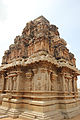 Shrine outer wall relief and tower at Hazara Rama temple in Hampi.JPG
