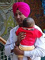 Sikh Youth with Child - McLeod Ganj - Himachal Pradesh - India (26708335071).jpg