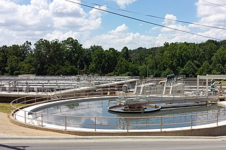 Siloam Springs, Arkansas - Primary clarifier (foreground) and aeration basins (background) at Siloam Springs Wastewater Treatment Plant