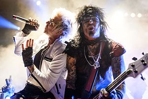 Nikki Sixx - Sixx (right) performing as part of Sixx:A.M. with James Michael in 2016.