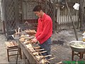 Skewered chicken, fish and bread on the grill.JPG