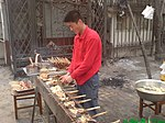 File:Skewered chicken, fish and bread on the grill.JPG