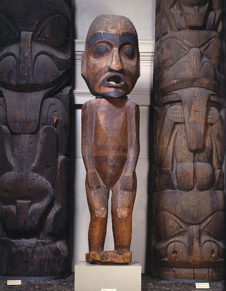 Potlatch - Speaker Figure, 19th century, Brooklyn Museum, the figure represents a speaker at a potlatch. An orator standing behind the figure would have spoken through its mouth, announcing the names of arriving guests.