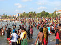 Sri Lanka - Crowd of people bathing clothed in sea.jpg