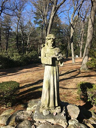 Francis of Assisi - A garden statue of Francis of Assisi with birds