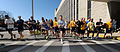Staff and students assigned to U.S. Naval War College (NWC) in Newport, R.I., race from the starting line during the President's Cup 5K race May 10, 2013 130510-N-PX557-027.jpg