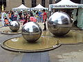 Stainless steel spheres and market stalls, Millennium Square, Sheffield - DSC07481.JPG