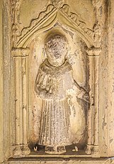 Statue in Cloisters said to have the cure for toothache. You can see teeth as votive offerings at the foot of the statue!.jpg