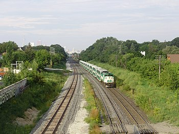 English: GO Transit's locomotive #563 pushes i...
