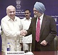 Sushil Kumar Shinde and the Deputy Chairman, Planning Commission, Shri Montek Singh Ahluwalia at signing of Power Purchase Agreement (PPA) for the ultra mega power projects of Sasan and Mundra, in New Delhi.jpg