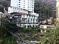 Suspension footbridge over the river at Lushan Hot Spring.jpg