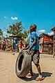 Tanzanian child playing with tire.jpg