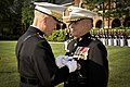 The 35th Commandant of the Marine Corps, Gen. James F. Amos, left, presents the Defense Distinguished Service Medal to Gen. George J. Flynn during Flynn's retirement ceremony at Marine Barracks Washington 130509-M-LU710-201.jpg