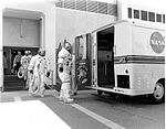 The Apollo 13 crewmembers make their way to the Transfer Van for the trip out to the launch pad.jpg