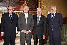 Carter, Ahtisaari, Hague, and Brahmdi standing next to each other.
