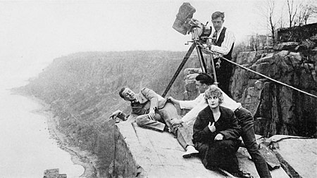 Pearl White, Antonio Moreno, director George B. Seitz, and cinematographer Arthur Charles Miller at Cliffhanger Point on the Hudson Palisades The House of Hate (1918) - 1.jpg