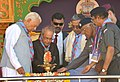 The President, Shri Pranab Mukherjee lighting the lamp at the inauguration of the 17th National Jamboree of the Bharat Scout and Guides, at Mysore.jpg