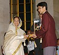 The President, Smt. Pratibha Patil presenting the Arjuna Award -2006 to Shri B. Chetan Anand for Badminton at a glittering function, in New Delhi on August 29, 2007.jpg