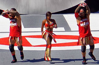 The Usos - The Usos with Naomi making their entrance to the ring at the WrestleMania 31 pre-show in March 2015
