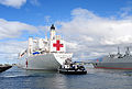 The hospital ship USNS Mercy (T-AH 19) arrives at Joint Base Pearl Harbor-Hickam, Hawaii, June 25, 2014, in preparation for exercise Rim of the Pacific (RIMPAC) 2014 140625-N-QG393-048.jpg
