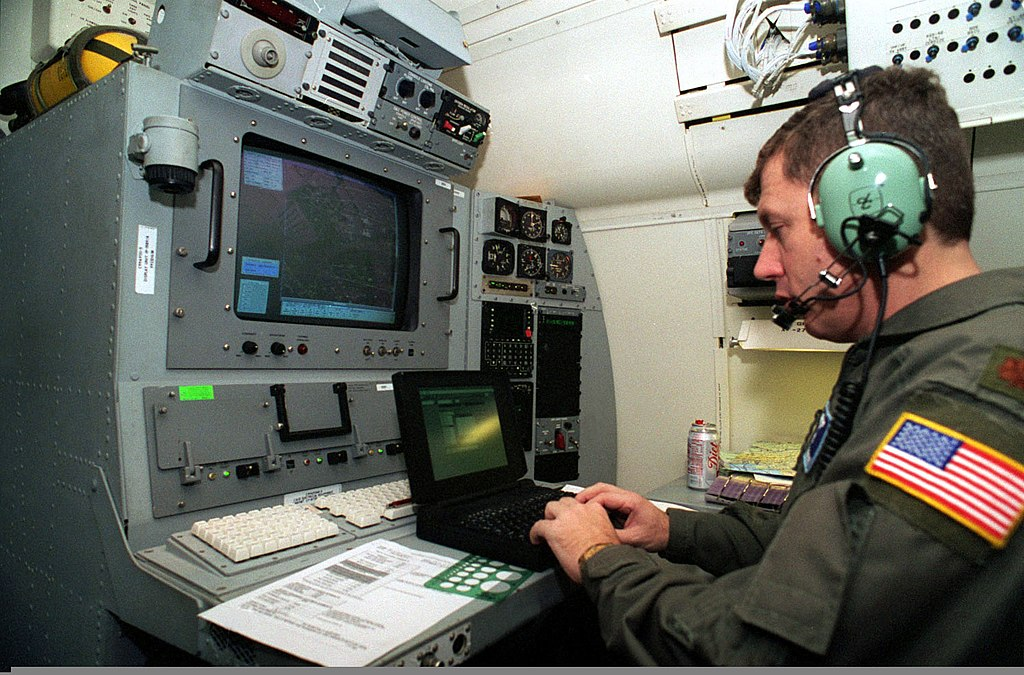 File:The navigation officer on a Boeing 707 aircraft, leaving Rhein Main Air  Base, Germany, plots a course using a laptop computer in connection with  the Joint Surveillance Target Attack Radar System (J-STARS)